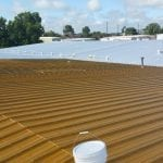 New paint coat being applied to steel commercial roof in San Antonio | WeatherTech Roofing San Antonio Roofer Contractor Company Residential and Commercial