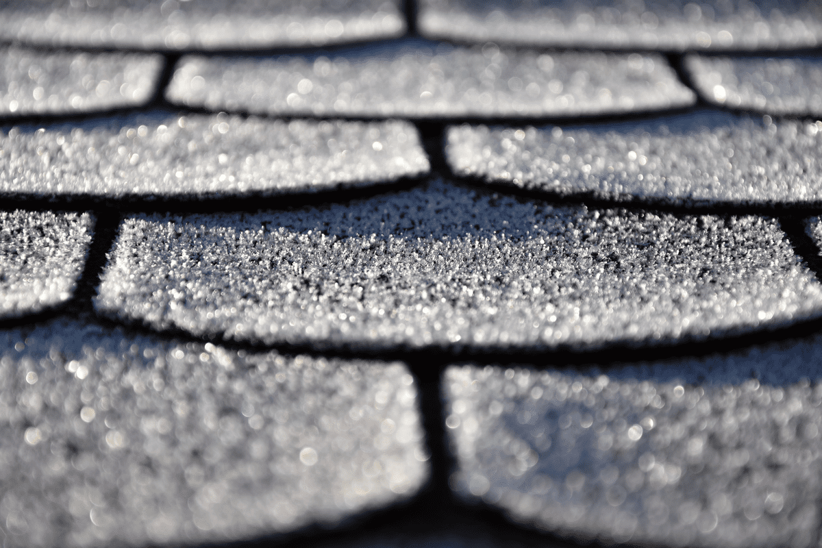 A close up of asphalt shingles on a San Antonio roofing system