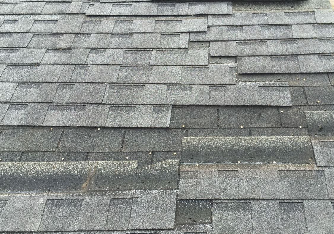 Wind damage on a San Antonio roofing system