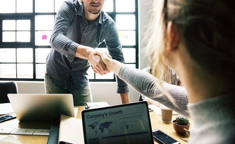 workplace talent shaking hands