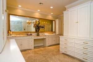 Berardo Bathroom Renovation with white cabinets, stained glass windows, large mirror over double vanity