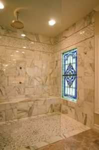 Berardo Bathroom Renovation with white cabinets, stained glass windows, walk in shower with bench and over head shower