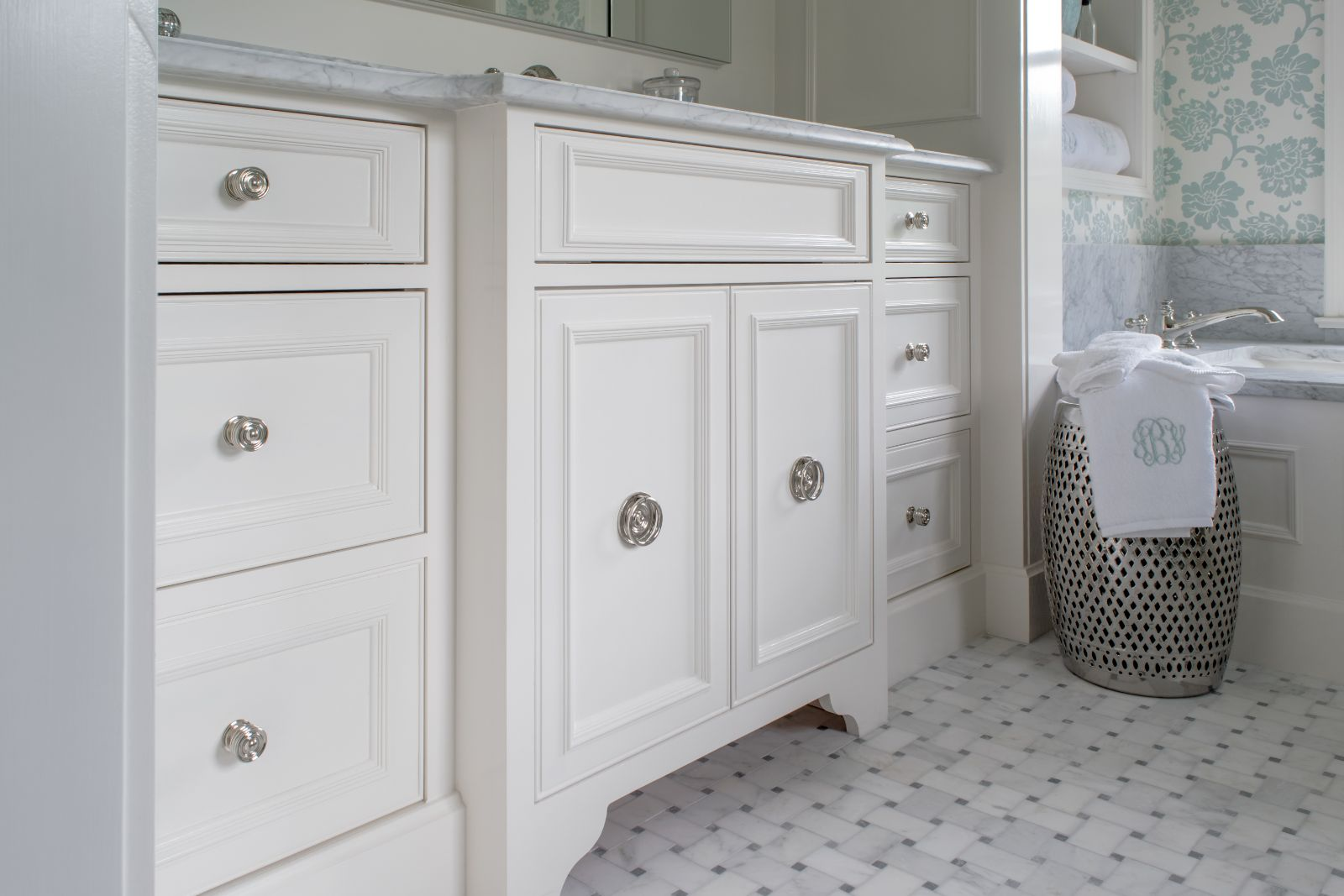Boyce Bathroom Renovation with white cabinets, tiled floor, and silver accents