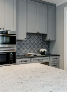 Donnelly Kitchen Renovation with grey cabinets, marble counter top, double over, and tiled back splash