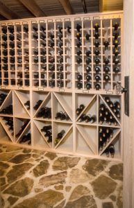 Donnelly special project wine cellar with wooden wine rack and stone flooring
