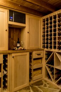 Donnelly special project wine cellar with wooden cabinets and wine rack