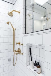 Edwards Marshall Bathroom Renovation with walk shower, gold accents, and see through window