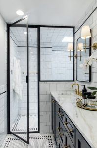 Edwards Marshall Bathroom Renovation with walk in shower, black trim, and marble counter top