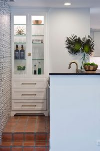 Edwards Marshall Special Project Wet bar with liquor cabinet and pattern wall paper