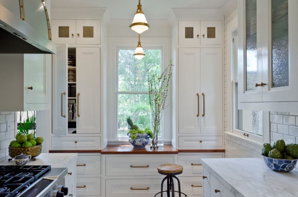 Giese Kitchen Renovation with kitchen window, marble counter tops, and cabinets with windows
