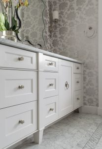 Hagee Bathroom Renovation white vanity with stainless steel fixtures