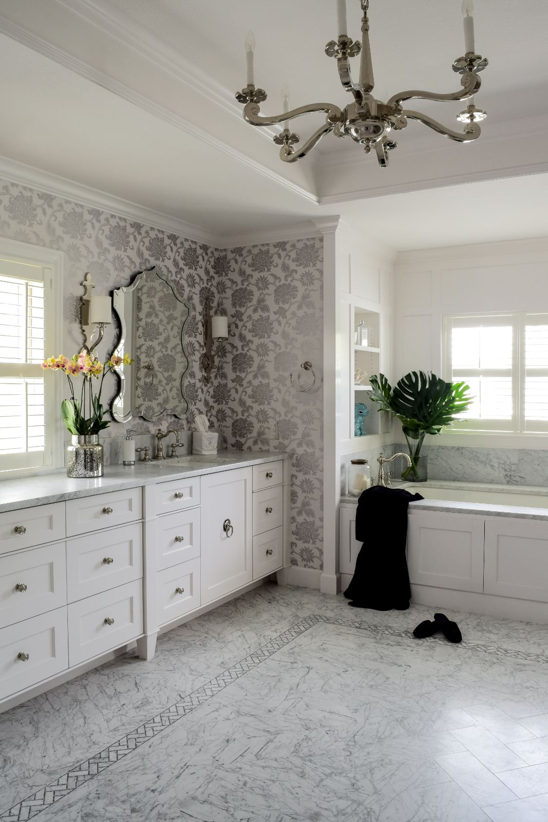 Hagee Bathroom Renovation with floral wall paper, double vanity on marble counter, and bathtub