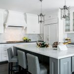 Hagee Kitchen Renovation with light green kitchen island, hanging light fixtures, and white cabinets