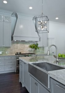 Lanzel Banos Kitchen Renovation with marble kitchen island, marble back splash, and farm style kitchen sink