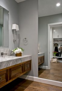 Mezey Bathroom Renovation with marble counter top, brown cabinets, tall mirror