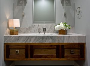 Mezey Bathroom Renovation with marble counter vanity and wood cabinets