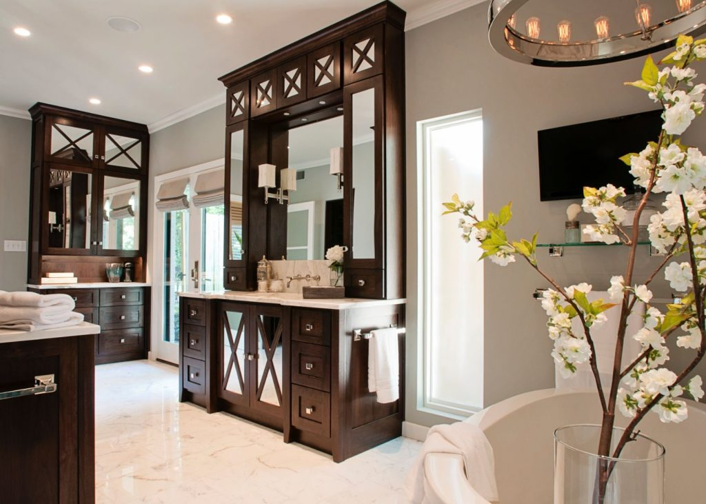 Penner Bathroom Renovation with brown cabinets, mirrors, and double doors