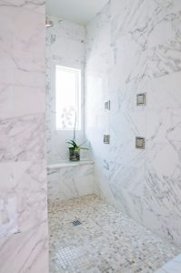 Penner Bathroom Renovation with walk in shower, marble tile on walls and floor, free standing bath tub