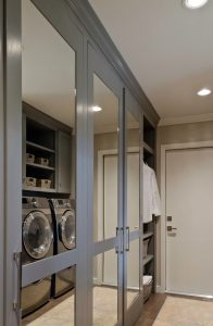 Penner laundry room renovation with mirrored doors