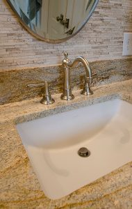 Pierce Bathroom Renovation with sink and stone back splash