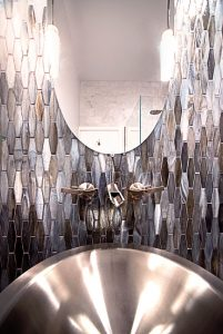 Rath Bathroom Renovation closed up with tiled purple metallic wall, stainless steel sink, and oval mirror
