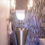 Rath Bathroom Renovation with tiled purple metallic wall, white tiled floor, and oval mirror