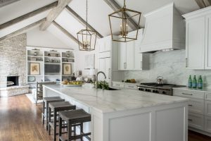 Watson Kitchen with wood ceiling beams, white cabinets, marble counter tops, and wooden floors, and large kitchen island