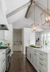 Watson Kitchen with wood ceiling beams, white cabinets, marble counter tops, and wooden floors