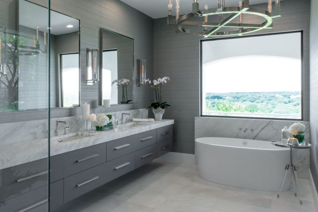 Womack Bathroom Renovation with marble counter tops and grey cabinets, double vanity