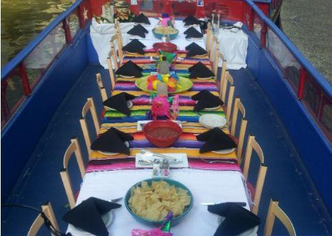 River barge tables set by Iron Cactus Mexican Grill & Margarita Bar