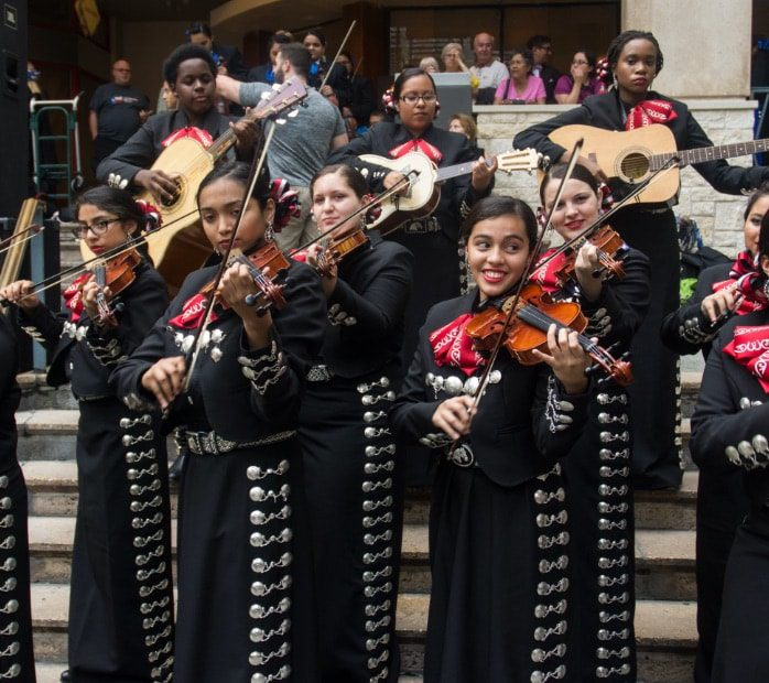 Mariachis performing on the San Antonio River Walk