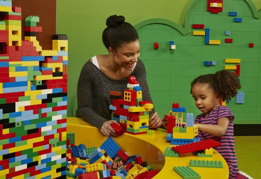 Child playing with Duplo blocks