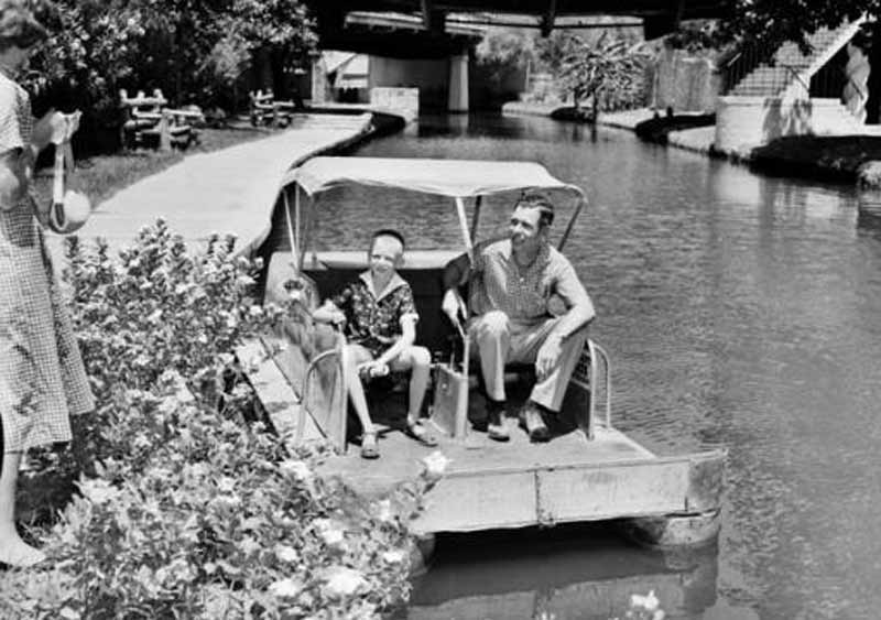 Father and son on a river boat in 1956