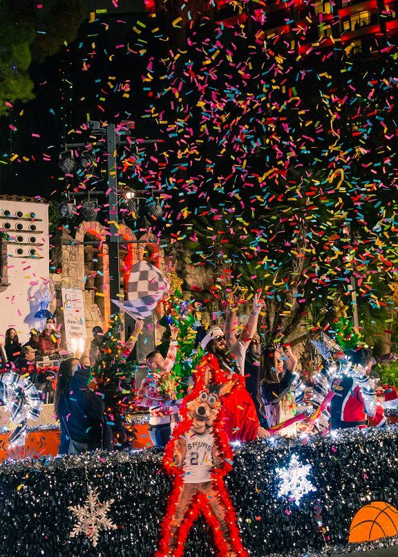 Confetti cannons on the Spurs river float
