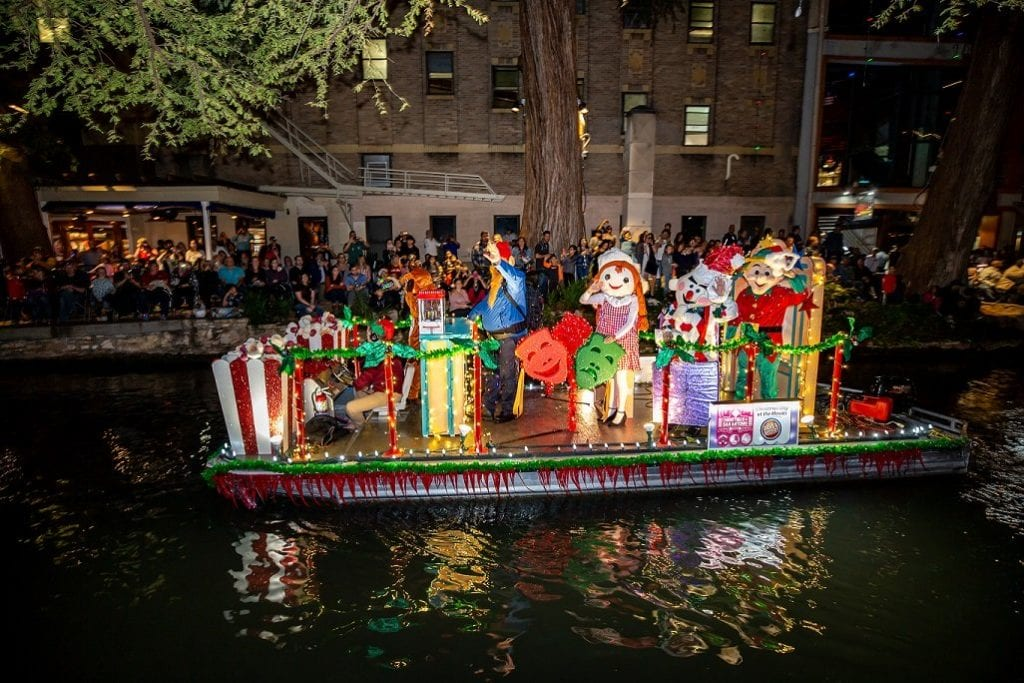 Colorful river float in the Ford Holiday River Parade