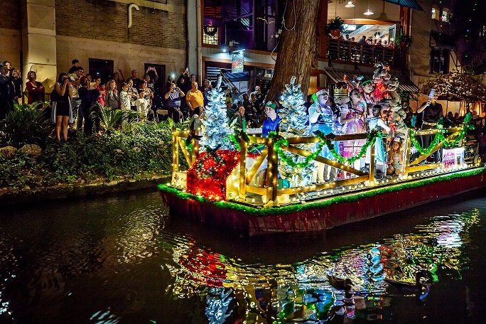 River float covered with lights in the Ford Holiday River Parade