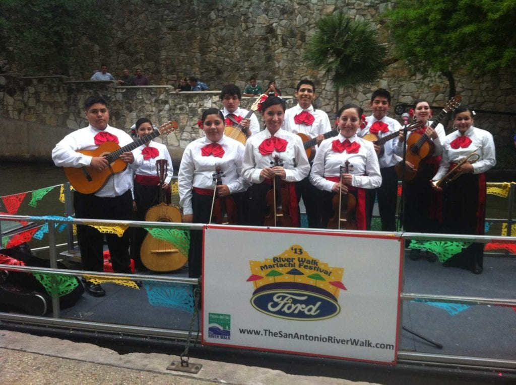 Mariachis onboard a Ford Mariachi Festival river barge