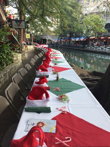 Tables set along the River Walk for the Ford Holiday River Parade