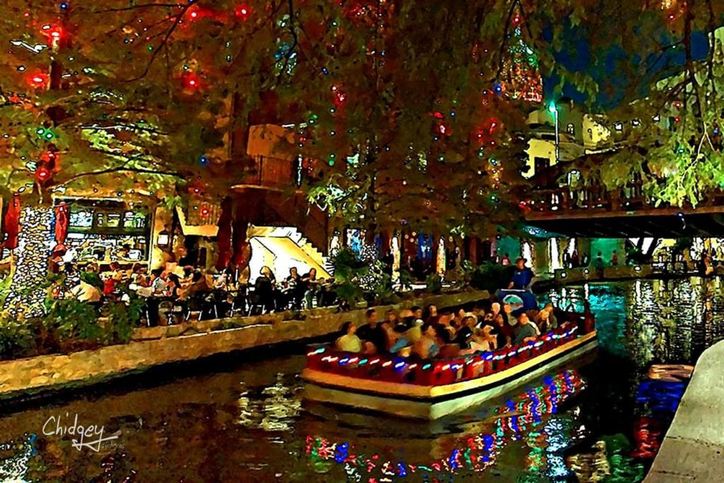 Boat touring the river under the holiday lights