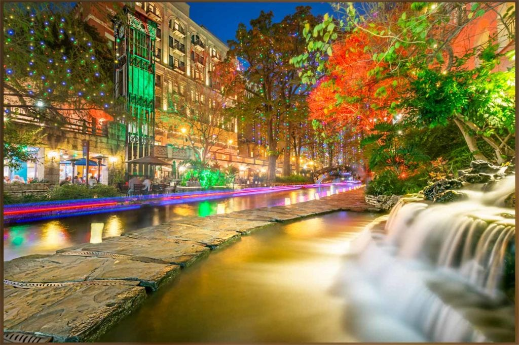River Walk lit up by colorful lights