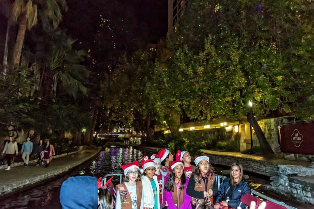 Girl scouts caroling on the San Antonio River