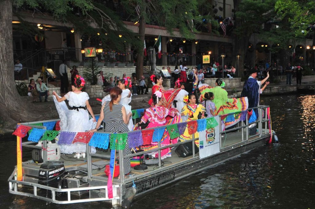 Baile Folklorico dancers on a boat in the Ford Mariachi Festival