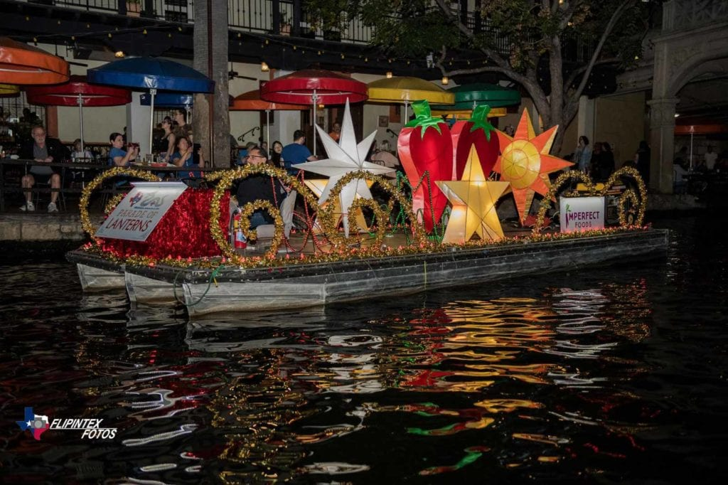 The Imperfect Foods river float at the Ford Parade of Lanterns