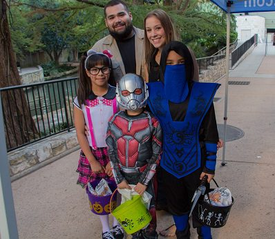 Family in costume for Haunted River, Jr.