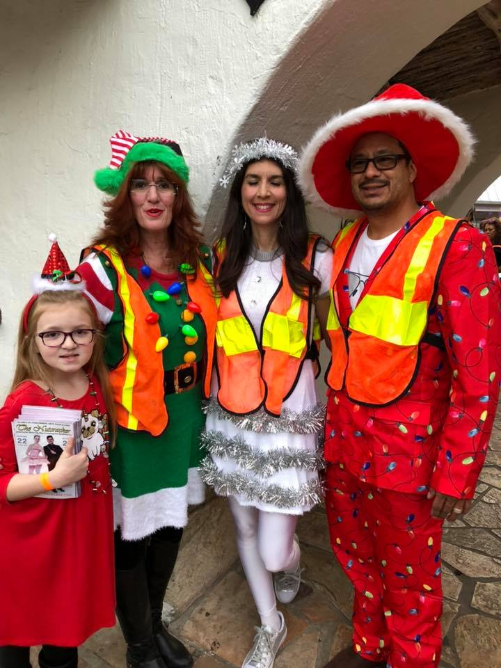 Volunteers in Christmas costumes