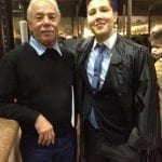 sleepy grandfather and grandson at his graduation