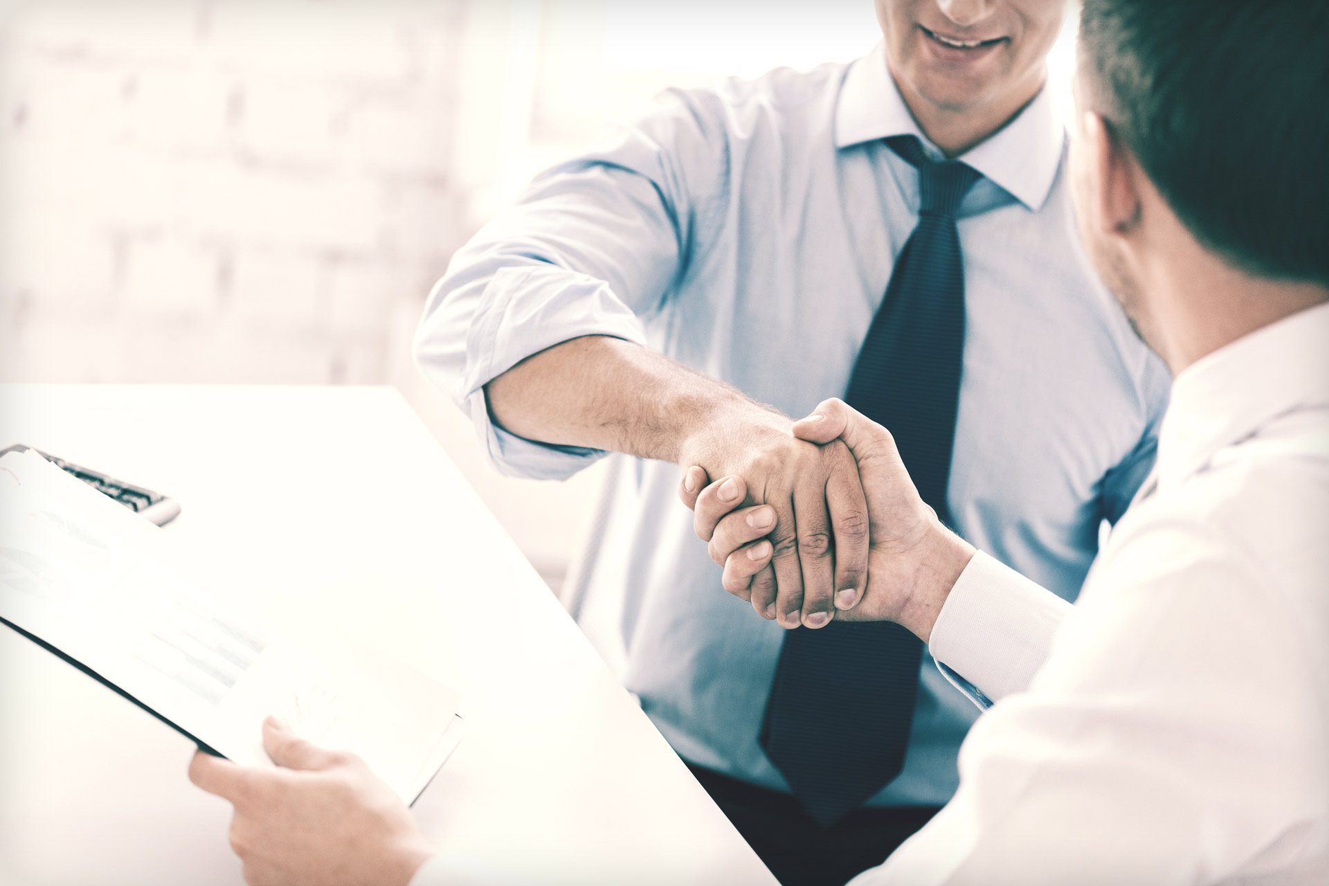happy handshake in greeting or business deal