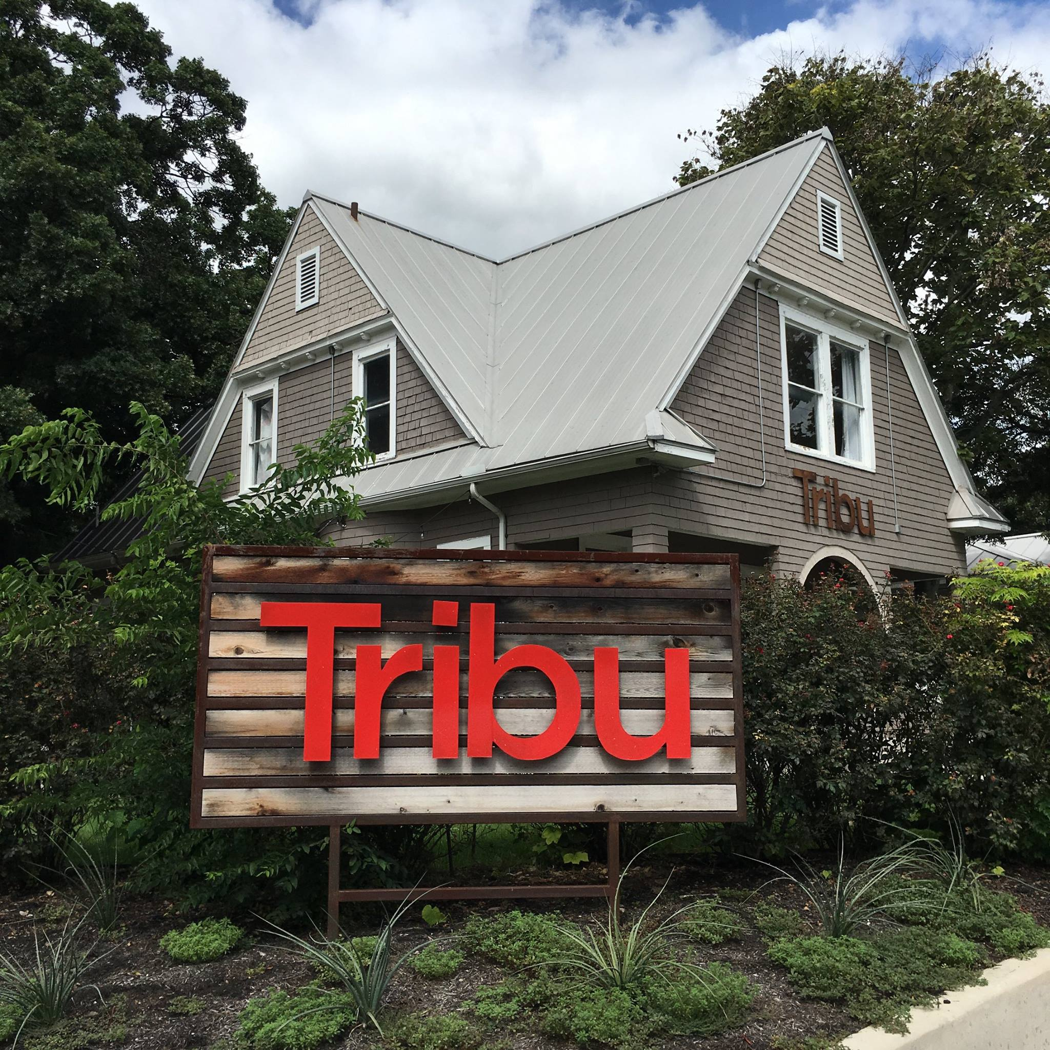 Tribu San Antonio Texas digital marketing advertising graphic design content strategy social media agency firm historic home downtown The Pearl 801 Quincy St the tribe home red