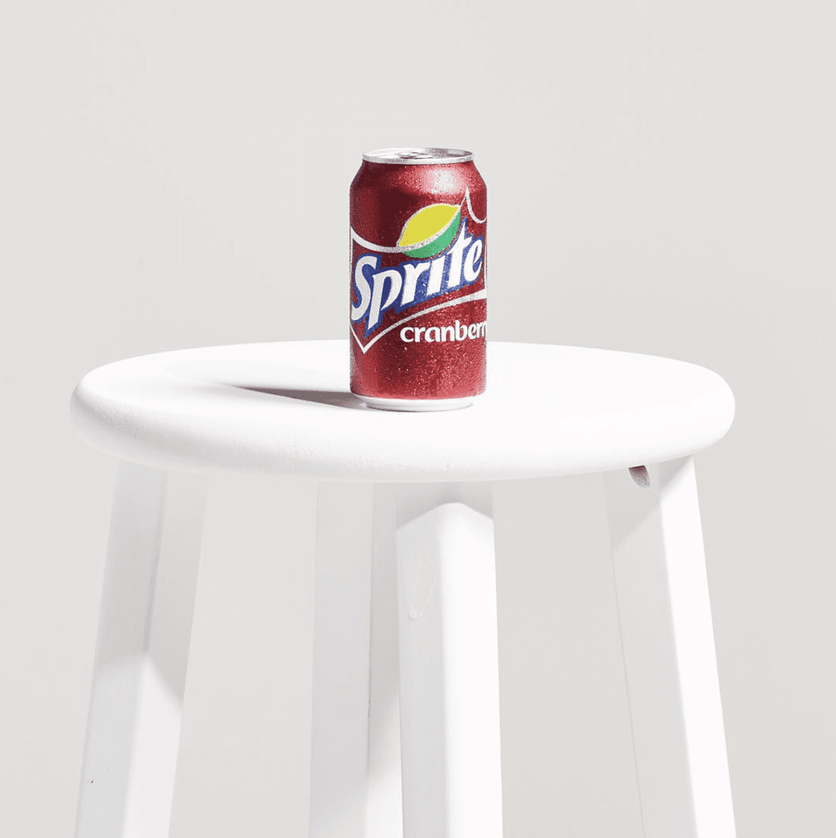 sprite cranberry can sitting on a stool | Tribu Digital Marketing